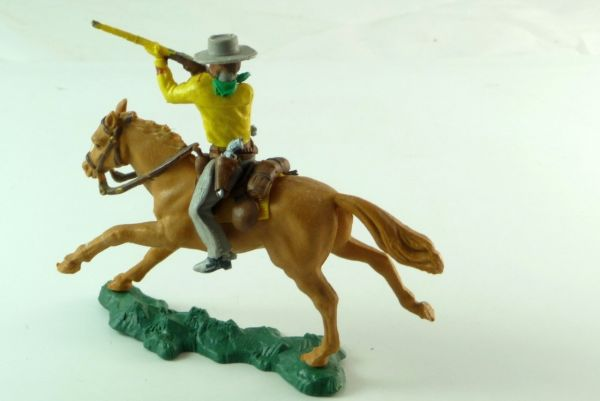 Britains Cowboy mounted, firing with rifle, 2 pistols in belt