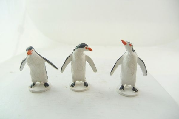 Britains 3 penguins in different positions