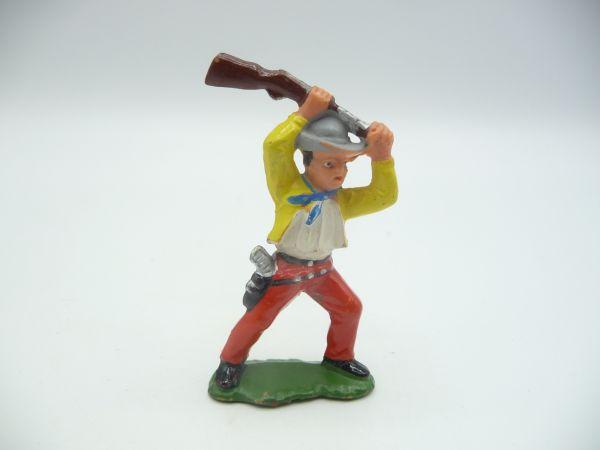 Cowboy kolbenschlagend (gelbe Jacke)