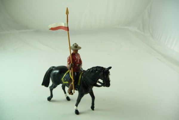 Britains Mountie riding with flag