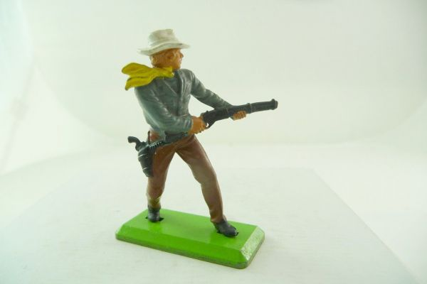 Britains Deetail Cowboy with firing with rifle from the hip, grey shirt