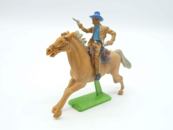 Britains Deetail Cowboy reitend mit 2 Pistolen