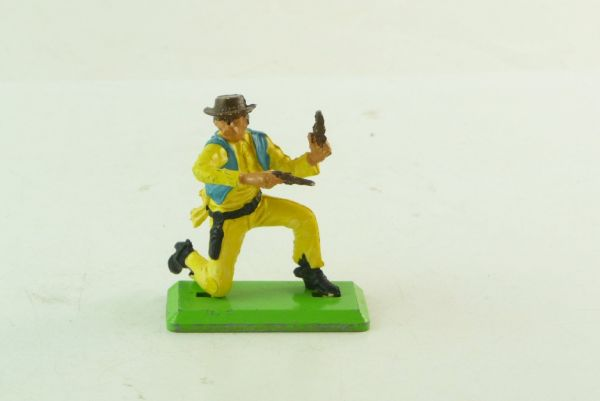 Britains Deetail Cowboy kneeling, yellow/turquois - rare colour combination