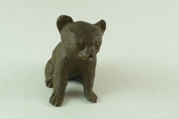Brown bear cub sitting - very good condition