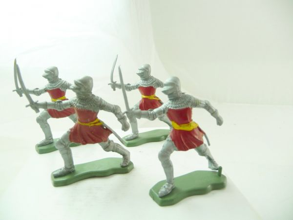 Britains Deetail 4 knights attacking with sword, red/silver