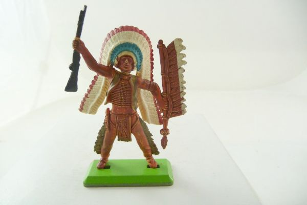 Britains Deetail Indian standing, holding up rifle, with spear, waistcoat golden