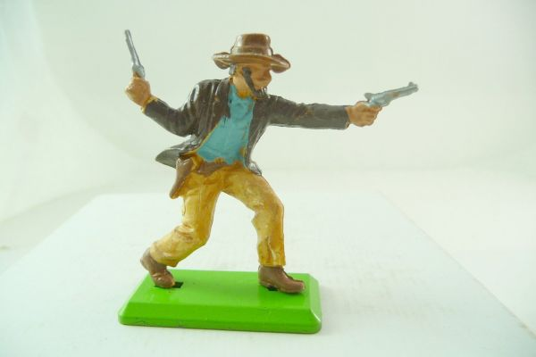 Britains Deetail Cowboy firing with 2 pistols, brown clothes