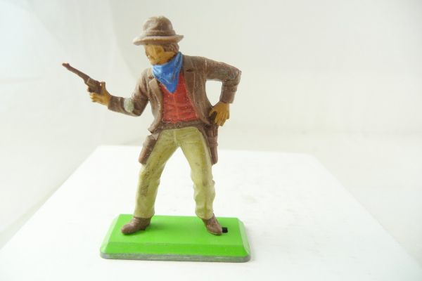 Britains Deetail Cowboy standing, firing with pistol at side, brown jacket, beige pants
