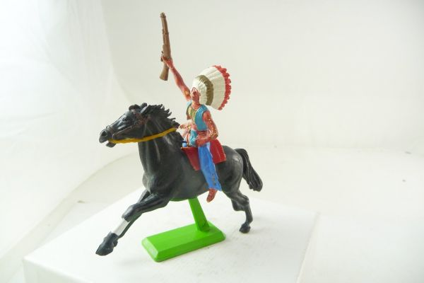 Britains Deetail Indian riding, holding up rifle