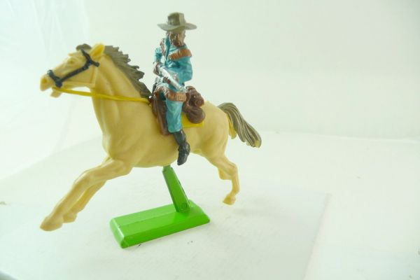Britains Deetail Cowboy riding with rifle (made in China) - brand new