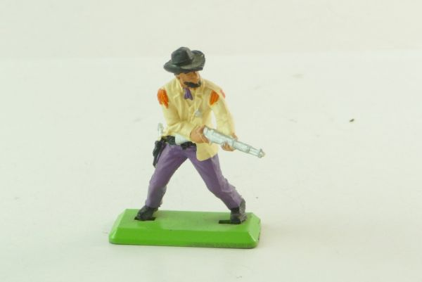 Britains Deetail Sheriff, firing with rifle from the hip, beige/purple