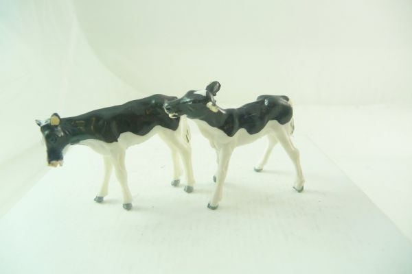 Britains 2 calves, black/white - rare positions