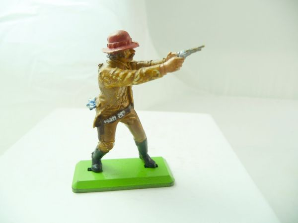 Britains Deetail Cowboy standing, firing ambidextrous with pistol, light-brown