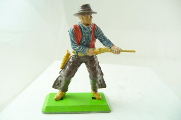 Britains Deetail Cowboy standing, firing with rifle from the hip