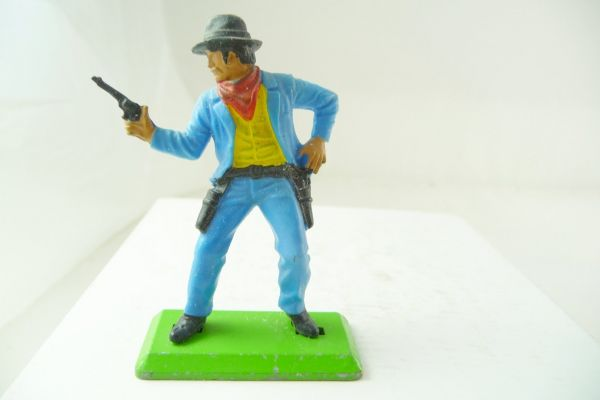 Britains Deetail Cowboy standing, firing with pistol at side, blue jacket