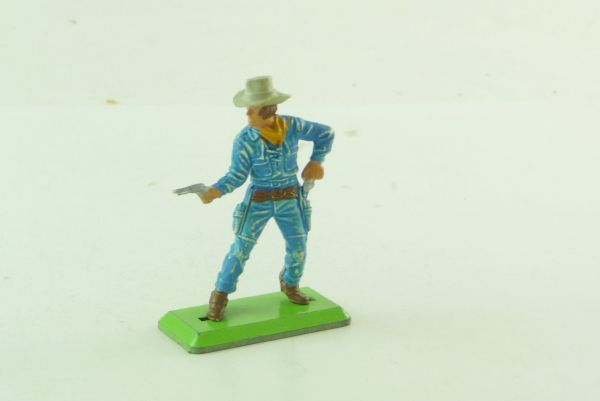 Britains Deetail Cowboy standing, pulling 2 pistols (medium-blue)