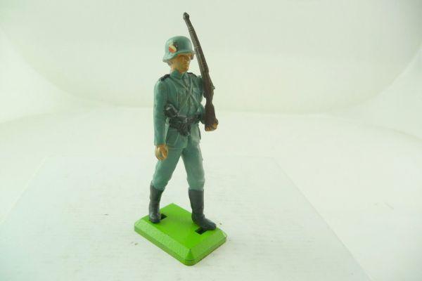 Britains Deetail German soldier, rifle shouldered, with emblem on helmet