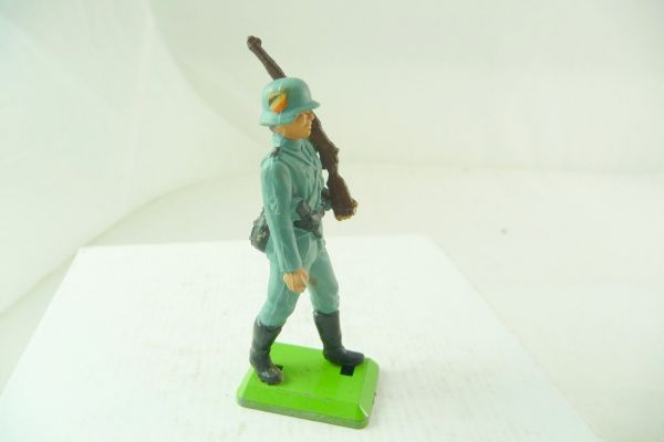 Britains Deetail German soldier, rifle shouldered, with emblem on helmet