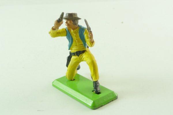 Britains Deetail Cowboy kneeling, firing with 2 pistols upwards