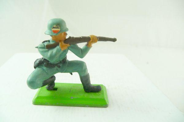 Britains Deetail German soldier kneeling firing with rifle, with emblem on helmet