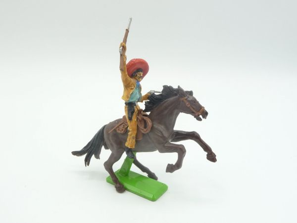 Britains Deetail Mexican riding with rifle up + firing with pistol