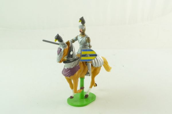 Britains Deetail Movable knight riding with long sword and shield
